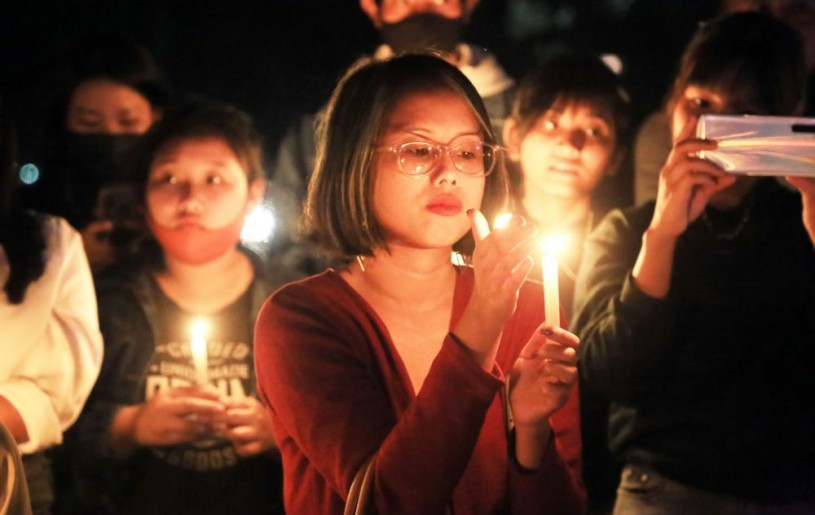 IN SOLIDARITY: A woman holds a candle during the candlelight vigil held by citizens of Dimapur on March 7 in solidarity with the people in Myanmar who are protesting against military coup in the country. Hundreds attended the event held at The Garden premise in Supermarket area, Dimapur on Sunday evening. (Morung Photo by Soreishim Mahong)