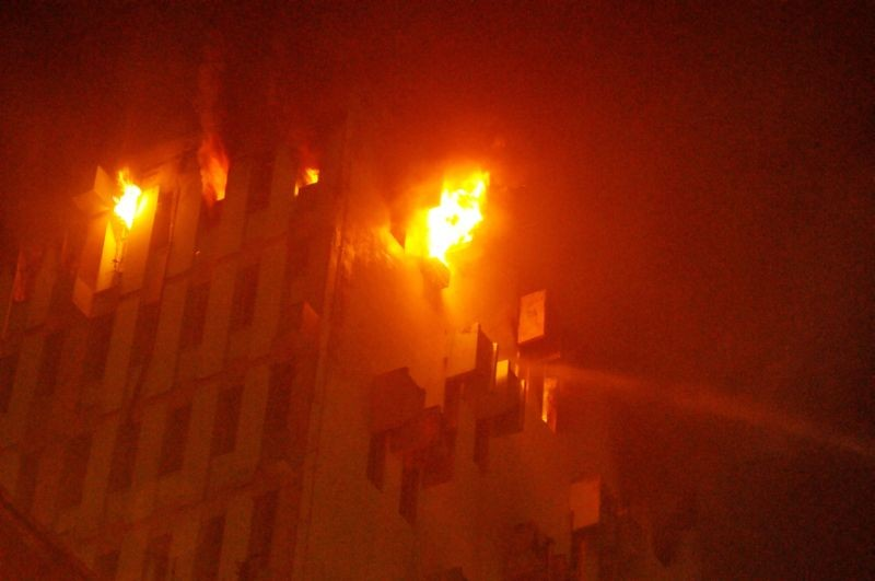 Fire breaks out at the 12th floor of a multi-storeyed building in Kolkata on March 8, 2021. (PTI Photo)