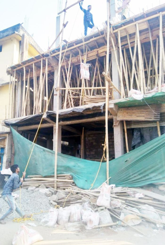 In this photo taken February 8, 2021, workers are seen hauling building materials using a makeshift pulley at a construction site in Dimapur. (Morung File Photo: For Representational Purposes Only)