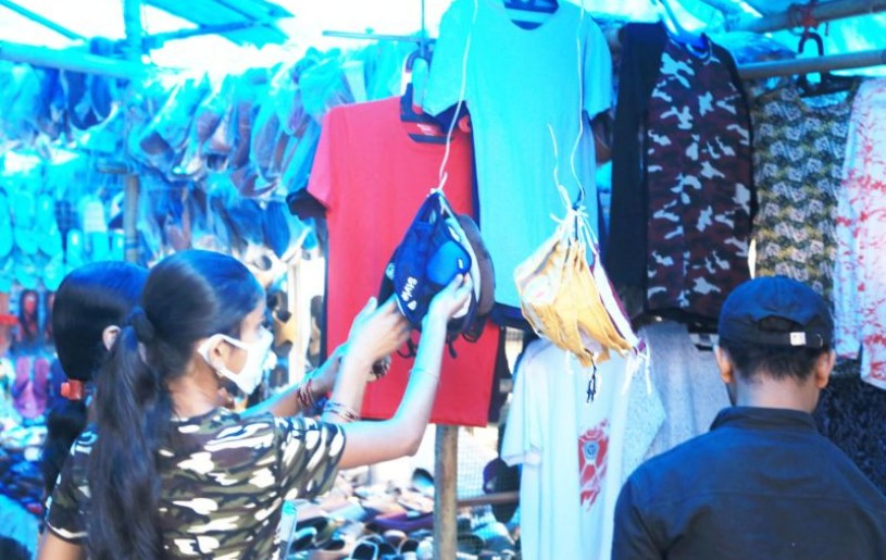 Shoppers examine fabric face masks on sale at a market in Dimapur. (Morung File Photo for representational purpose)
