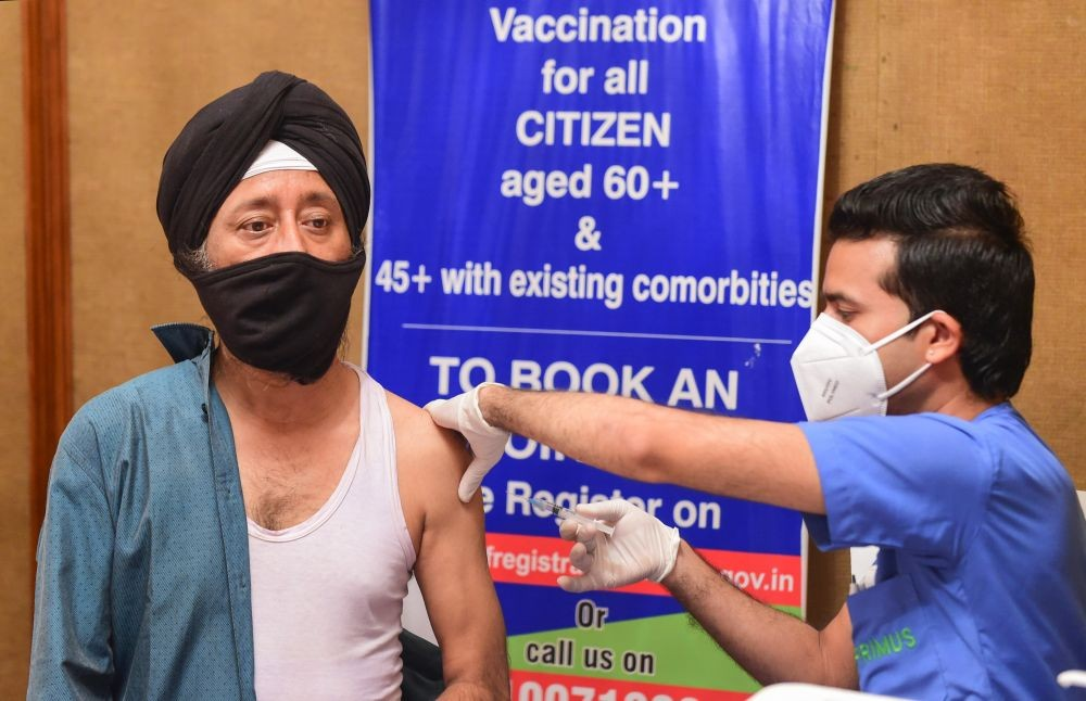 New Delhi: An employee of a five star hotel receives a COVID-19 vaccine dose, in New Delhi, Monday, April 12, 2021. Hospitality industry has been hit hard due to the ongoing COVID-19 pandemic. (PTI Photo/Kamal Kishore)