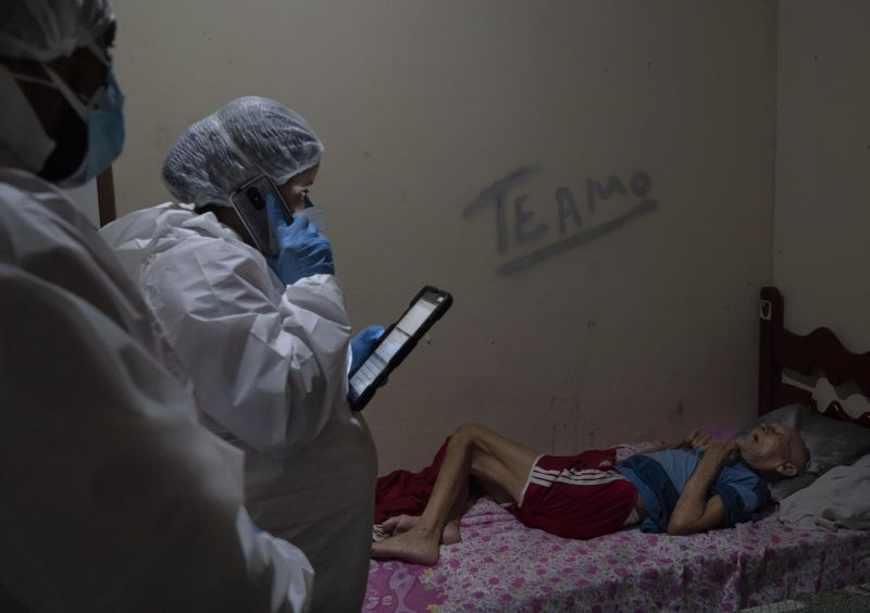 Duque de Caxias: Mobile Emergency Care Service (SAMU) worker Aline Moreira checks on an elderly COVID-19 patient before transferring him to a hospital in Duque de Caxias, Rio de Janeiro state, Brazil, Wednesday, April 7, 2021. AP/PTI
