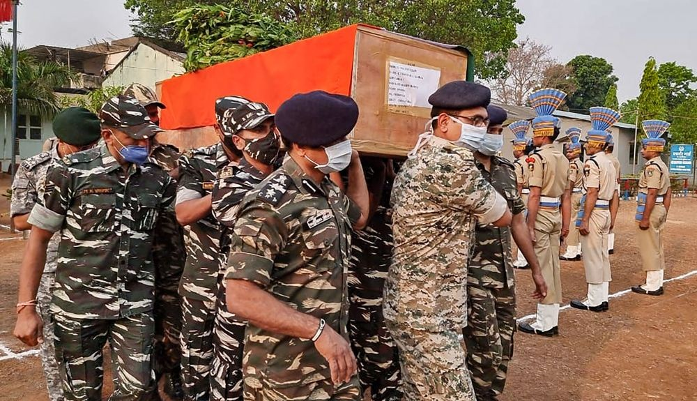 Bijapur: CRPF personnel carry the coffin of a paramilitary soldier who lost his life in an encounter with Maoists, in Bijapur district of Chhattisgarh, Sunday, April 04, 2021. (PTI Photo)