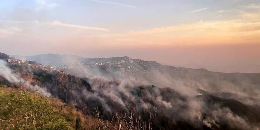 The fire which was initially concentrated in uninhabited forest areas surrounding Lunglei town spread to neighbouring village areas on April 25. (Photo Courtesy: Twitter)