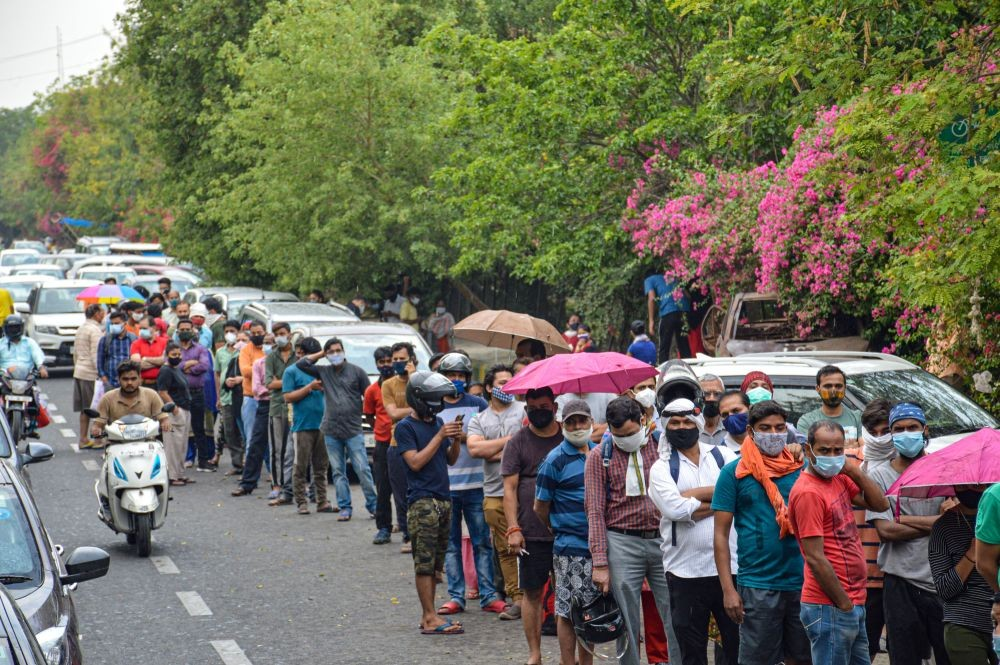 Indirapuram: People stand in a long queue to get  COVID-19 test, provided by a Sikh organisation at a Gurdwara in Indirapuram, Ghaziabad, Friday, April 23, 2021. (PTI Photo)