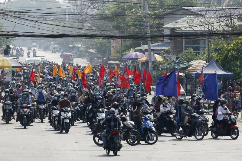 Protesters carry flags as they drive their motorcycles during an anti-coup protest in Mandalay, Myanmar on March 25, 2021. ( AP/PTI File Photo)