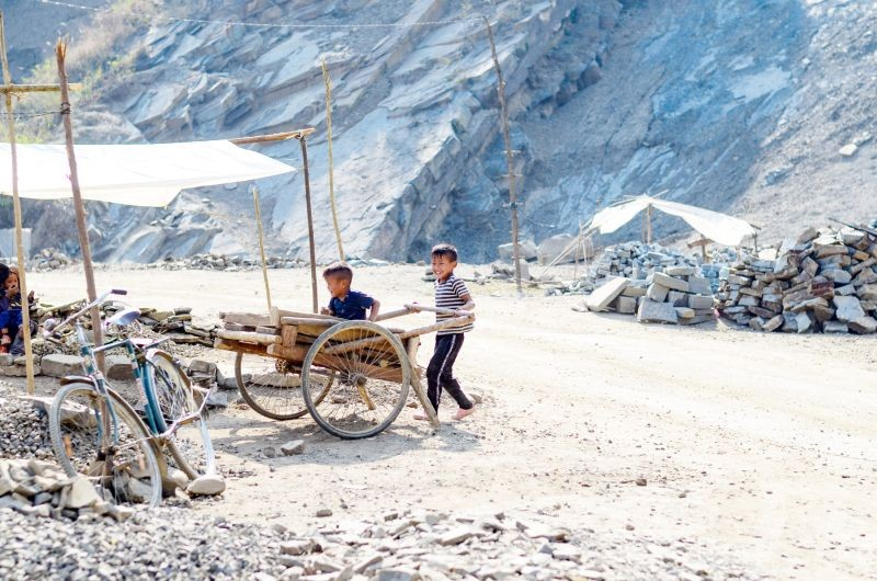 Two children playing in a hand cart near a quarry in Kuthur village of Tuensang district. (Morung Photo by Moses Hongang Chang)