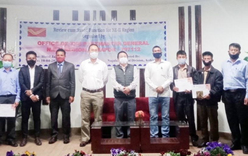 Awardees with K. Kevichusa and others during the 'Review cum Award Function' for employees of NE-II Region at Hotel Japfu, Kohima on April 10. (Morung Photo)