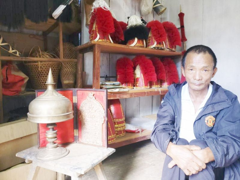 Bukhaio Khiamniungan is one of the few remaining craftsmen who make traditional Naga headgear. (Morung Photo)