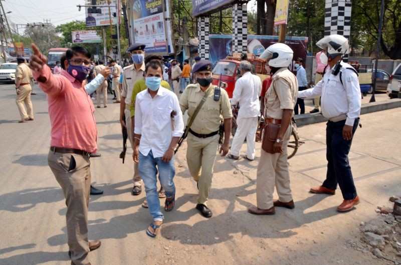 Police personnel detain people for not wearing masks, amid countrywide spike in COVID-19 cases, in Ranchi district on April 7. (PTI Photo)