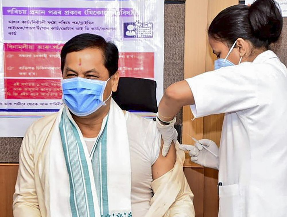 Guwahati: Assam Chief Minister Sarbananda Sonowal receives the first dose of COVID-19 vaccine, in Guwahati, Thursday, April 8, 2021. (PTI Photo)