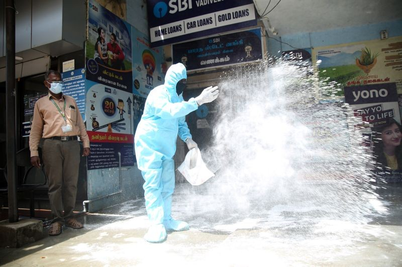 Corporation worker sanitize a locality, where a Vadiveswram SBI bank manager was detected with COVID-19, amid the rise in Covid-19 cases across the country, in Nagercoil on April 15, 2021. (PTI Photo)