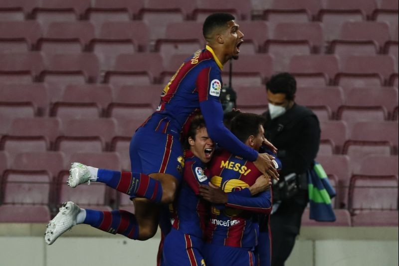Barcelona : Barcelona's Ousmane Dembele, right, celebrates with his teammates after scoring his side's opening goal during the Spanish La Liga soccer match between FC Barcelona and Valladolid CF at the Camp Nou stadium in Barcelona, Spain, Monday, April 5, 2021. AP/PTI