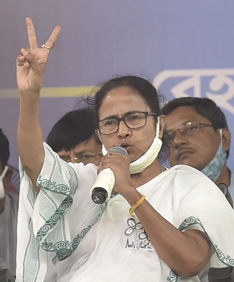 West Bengal Chief Minister and TMC supremo Mamata Banerjee addresses an election campaign rally in support of party candidates Ratna Chatterjee and Partha Chatterjee, ahead of the 4th phase of State Assembly polls, in Kolkata on April 8, 2021. (PTI Photo)