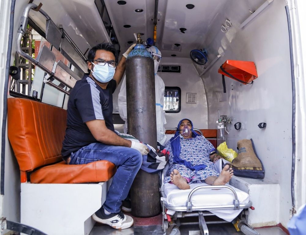 New Delhi: A COVID-19 patient waits to be allocated a bed at LNJP Hospital, amid shortage of beds and medical oxygen, as coronavirus cases surge in record numbers across the country, in New Delhi, Thursday, April 22, 2021. (PTI Photo)