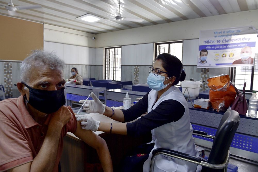 New Delhi: A medic administers a dose of Covid-19 vaccine to an elderly person, at Patparganj in New Delhi, Tuesday, May 25, 2021. (PTI Photo/Vijay Verma)