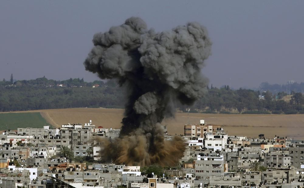 Smoke rises after an Israeli airstrike in Gaza City, Tuesday, May 11, 2021. (AP Photo/Hatem Moussa)