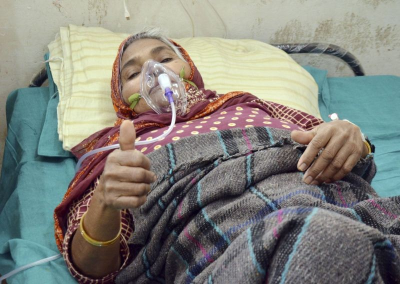 A COVID-19 patientshows victory sign as she fight against the coronavirus disease, at the temporary ward of COVID-19, in Ranchi on May 11, 2021. (PTI Photo)