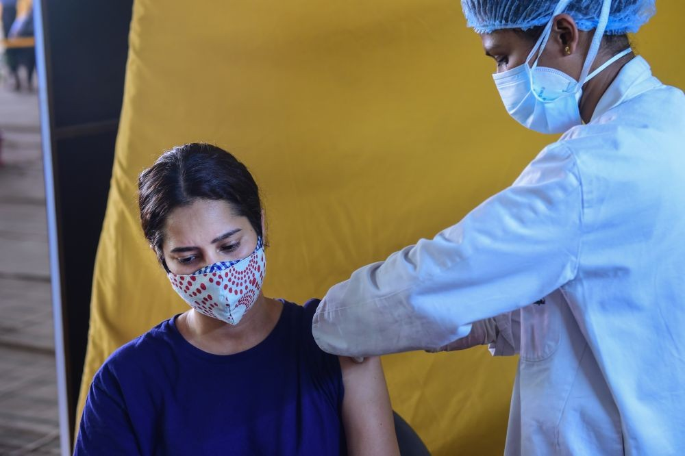 New Delhi: A young beneficiary receives her first dose of COVID-19 vaccine at Radha Soami Satsang, one of the largest COVID-19 vaccination sites, in New Delhi, Tuesday, May 4, 2021. (PTI Photo/Kamal Kishore)