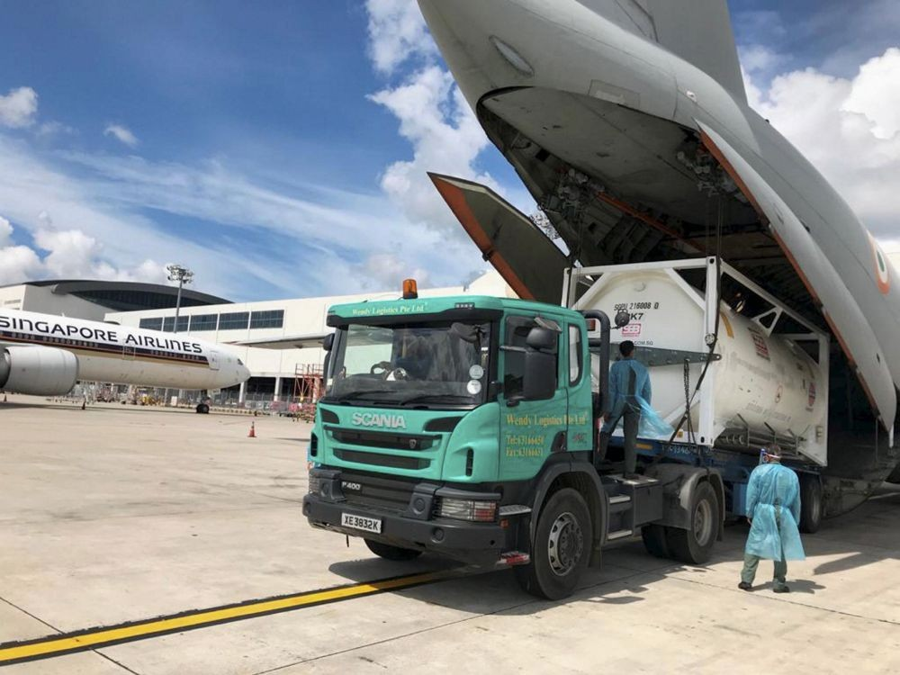 **EDS: IMAGE POSTED @IAF_MCC ON FRIDAY, MAY 8, 2021** Singapore: An IAF aircraft is loaded with oxygen container in Singapore for India's fight against COVID-19. (PTI Photo)