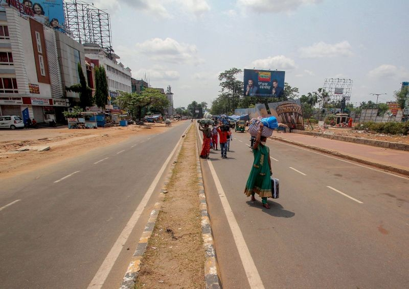 Migrants walk during COVID induced statewide  14-day lockdown in the wake of  rising coronavirus cases,  in Bhubaneswar on May 5, 2021. (PTI Photo)