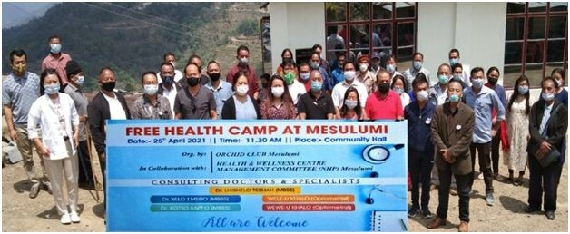 Members of Orchid Club and the medical team during the free health camp in Mesulumi.