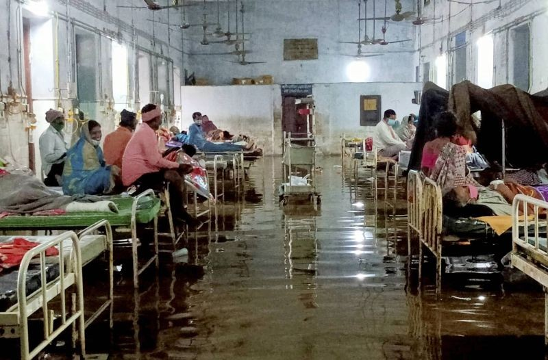 Katihar: A flooded ward of the Government Sadar Hospital following heavy rains in the aftermath of Cyclone 'Yaas', in Kathar district, Saturday, May 29, 2021. (PTI Photo)