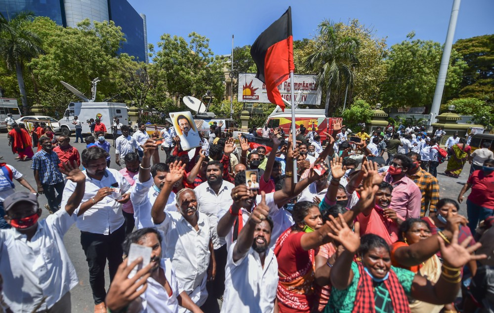 DMK Party workers celebrate during the counting day of Tamil Nadu Assembly polls results at their party headquarters, in Chennai on May 2. (PTI Photo)