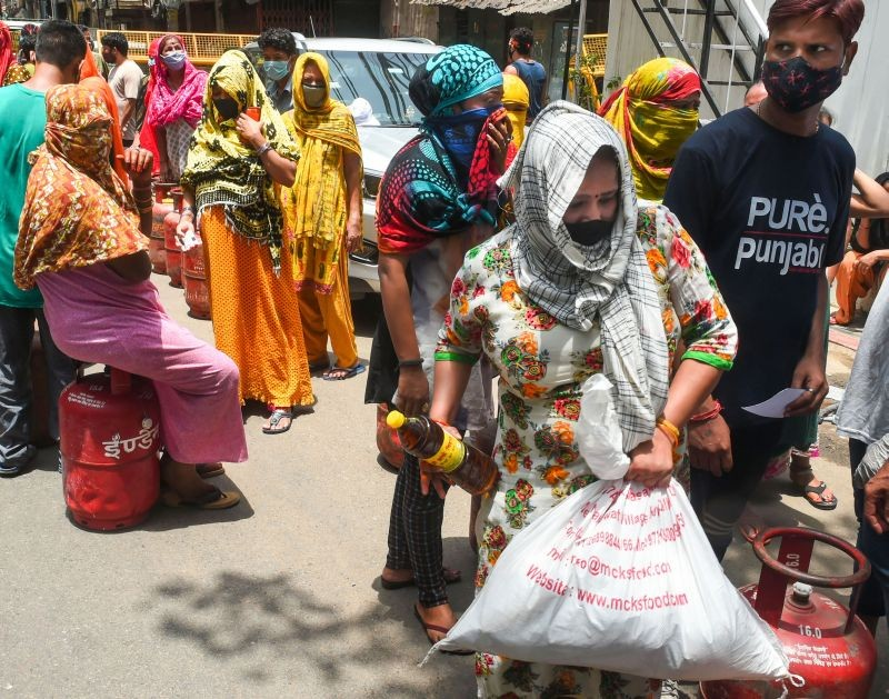New Delhi: Sex workers wait to recieve groceries and gas cylinders, distributed by Seva Bharti at GB Road, during  COVID-induced lockdown in New Delhi, Sunday, May 30, 2021. (PTI Photo/ Shahbaz Khan)