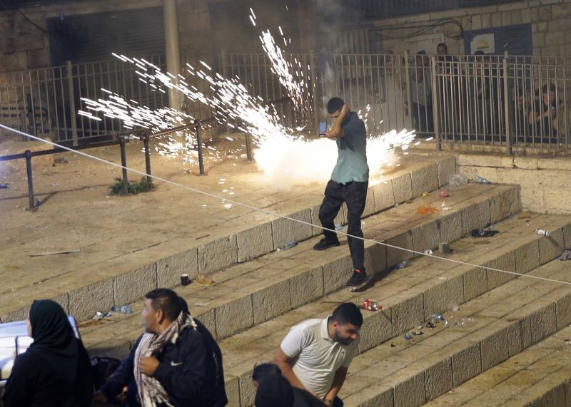 Palestinians run from stun grenades fired by Israeli police officers during clashes at Damascus Gate just outside Jerusalem's Old City on May 8, 2021. (AP/PTI Photo)