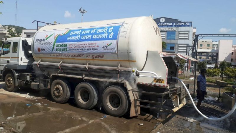 Vijayawada: A tanker from Odisha provides oxygen to a hospital for COVID-19 patients after it was provided green channel by the police for timely delivery,  in Vijayawada, Friday, May 7, 2021. (PTI Photo)
