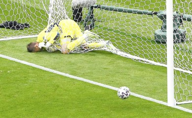 Scotland's goalkeeper David Marshall is caught in the goal's net after he failed to save a long distance shot by Czech Republic's Patrik Schick during the Euro 2020 soccer championship group D match between Scotland and Czech Republic at Hampden Park stadium in Glasgow on June 14. (AP Photo)