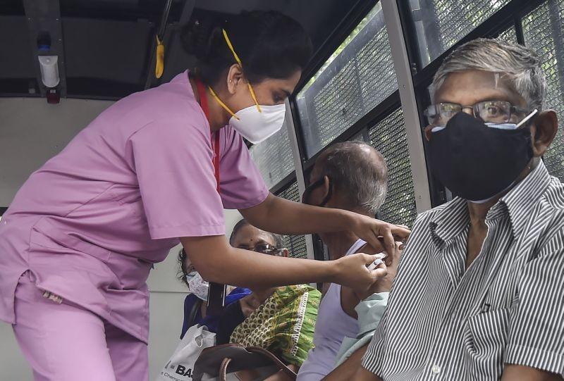 Kolkata: A medic administers a dose of the Covid-19 vaccine to a beneficiary, near East Bengal club, in Kolkata, Wednesday, June 9, 2021. (PTI Photo/Swapan Mahapatra)
