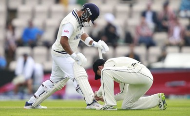 Southampton: A New Zealand player ties shoe laces of India's Ajinkya Rahane, left, during the third day of the World Test Championship final cricket match between New Zealand and India, at the Rose Bowl in Southampton, England, Sunday, June 20, 2021. AP/PTI(