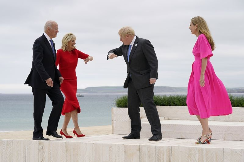 President Joe Biden and first lady Jill Biden are greeted by British Prime Minister Boris Johnson and his wife Carrie Johnson before posing for photos at the G-7 summit on June 11 in Carbis Bay, England. (AP/PTI Photo)