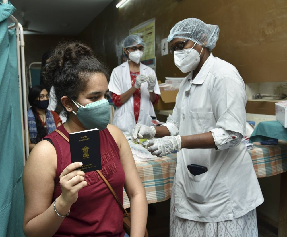 Hyderabad: A health worker administers COVID-19 vaccine to a student at a vaccination centre organised for students traveling abroad for higher studies, in Hyderabad, Tuesday, June 8, 2021. (PTI Photo)
