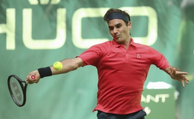 Switzerland's Roger Federer plays the ball during his ATP Tour Singles, Men, 1st Round match against Ilya Ivashka from Belarus in Halle, Germany, Monday, June 14, 2021. (Friso Gentsch/dpa via AP)