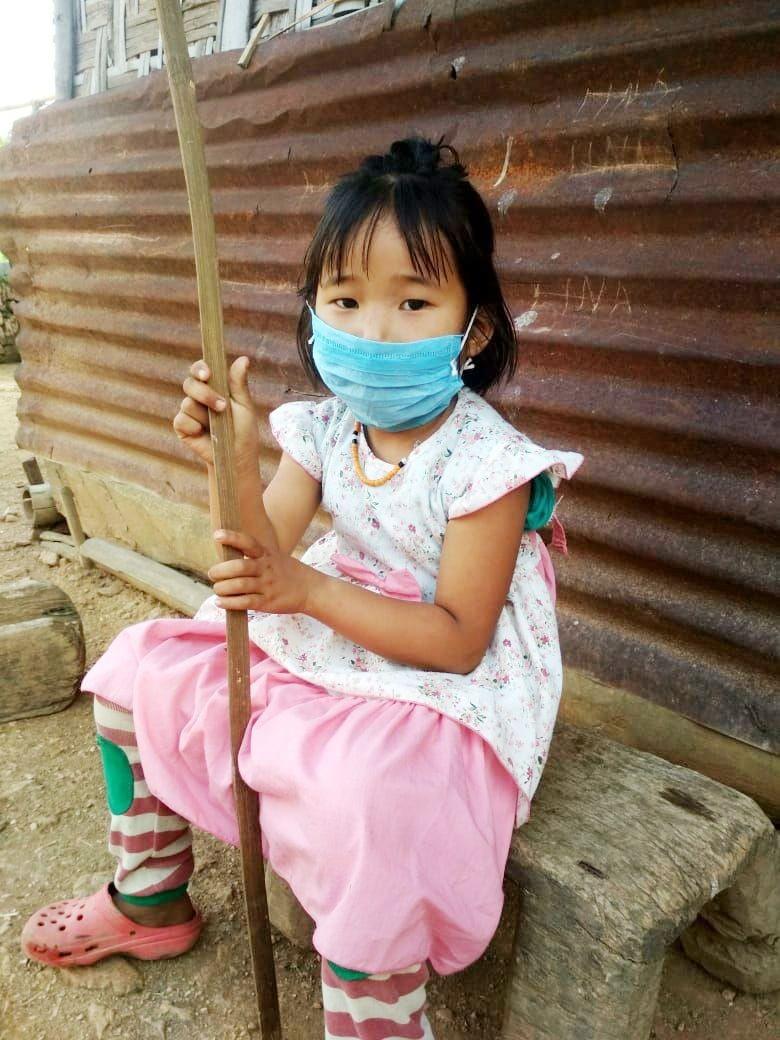 3-year old Lipavi sits outside her house in Hevolimi Village on June 4. (Photo Courtesy:IEC Bureau, CMO Office Zunheboto)