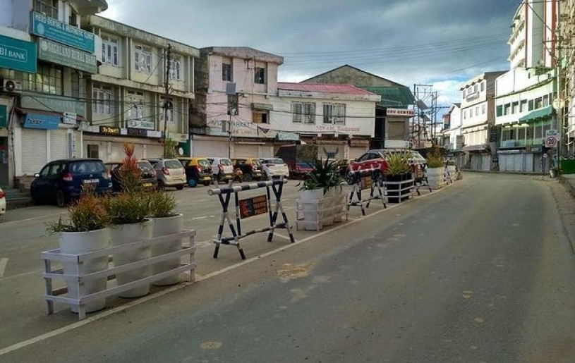 """Planters being placed as Traffic Bollards alongside Traffic Barricades at Old NST area by the Kohima Smart City as part of """"Streets for People"""" Challenge initiatives. (Photo Courtesy: Kohima Smart City)"""