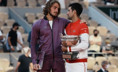 Serbia's Novak Djokovic, right, and Stefanos Tsitsipas of Greece hug while holding their trophies after their final match of the French Open tennis tournament at the Roland Garros stadium Sunday, June 13, 2021 in Paris. Djokovic won 6-7 (6), 2-6, 6-3, 6-2, 6-4. (AP Photo/Thibault Camus)