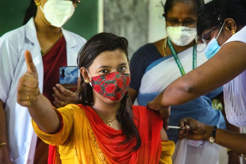 Kanyakumari: A woman shows thumbs up as she receives a dose of the COVID-19 vaccine, at a vaccination camp organised by Nagercoil Municipal Corporation, at Hindu college in Kanyakumari district, Monday, June 7, 2021. (PTI Photo)