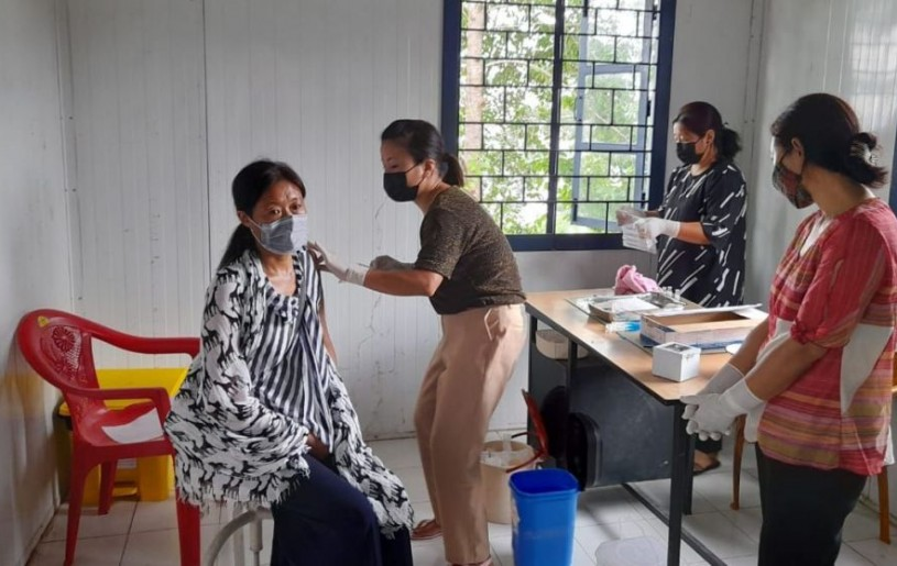 A beneficiary gets Covishield vaccine shot during the vaccination drive in Khensa village of Mokokchung district. (Photo Courtesy: KVC)