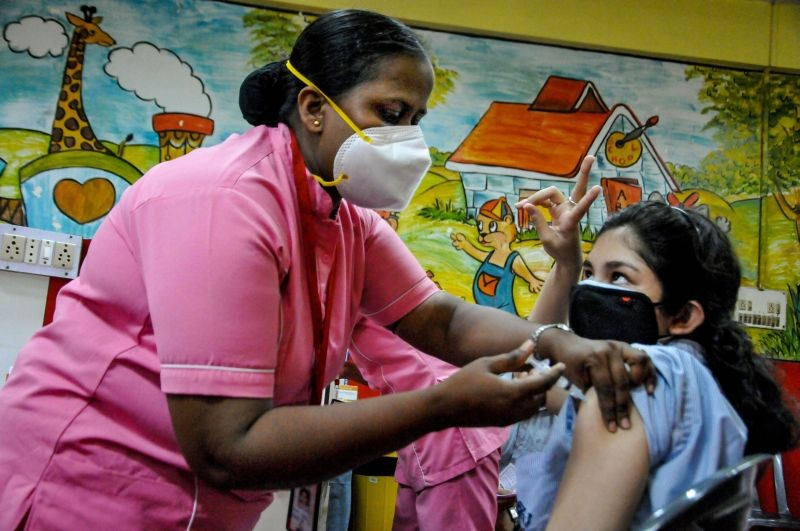 Kolkata: A medic administers the first dose of Covid-19 vaccine to  an outgoing class XII student of South Point school, at the school premises, in Kolkata, Sunday, June 6, 2021. (PTI Photo)