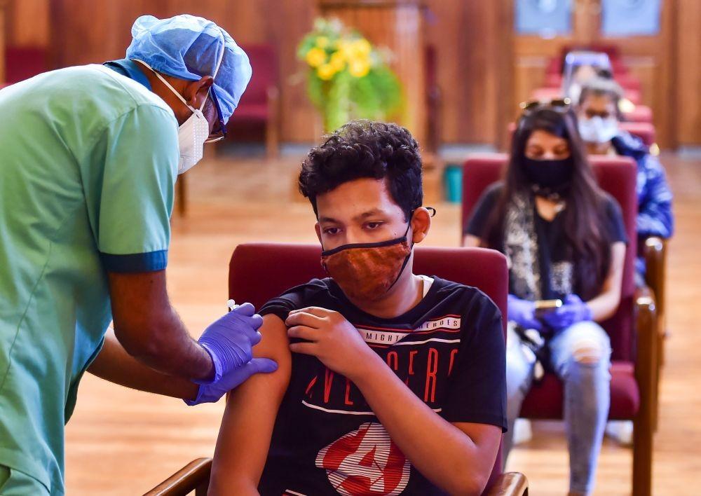 Bengaluru: A health worker administers a dose of the Covid-19 vaccine to a benificiary, in Bengaluru, Tuesday, June 1, 2021. (PTI Photo/Shailendra Bhojak)