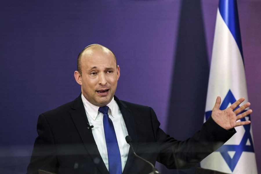In this June 6, 2021, photo, Naftali Bennett, Israeli parliament member from the Yamina party, gives a statement at the Knesset, Israel's parliament, in Jerusalem. If all goes according to plan, Israel will swear in a new government on Sunday, June 13, putting an end to Prime Minister Benjamin Netanyahu's record 12-year rule and a political crisis that led to four elections in less than two years. The next government, which will be led by the ultranationalist Bennett, has vowed to chart a new course aimed at healing the country's divisions and restoring a sense of normalcy. (AP Photo)
