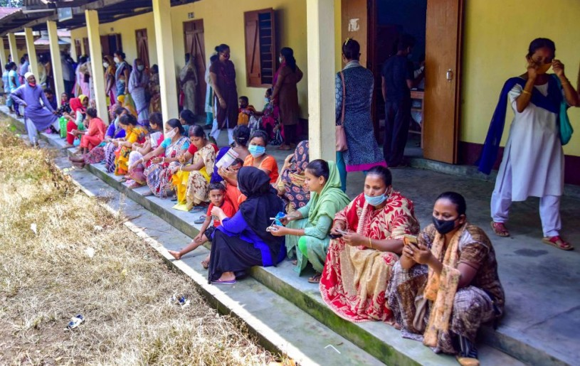 Nagaon: Beneficiaries wait in a queue to receive COVID-19 vaccine dose, at a centre in Nagaon district of Assam, Tuesday, June 22, 2021. (PTI Photo)