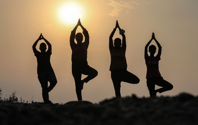 Jammu: Morning walkers perform yoga at Manda village ahead of International Yoga Day, in Jammu, Sunday, June 20, 2021. (PTI Photo)