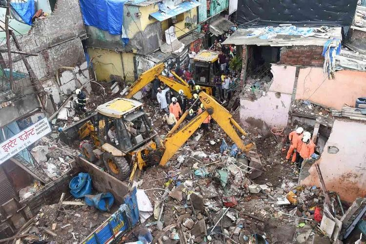 Mumbai: Rescue operation underway after a single-storey house collapsed on another structure in Malwani area on Wednesday night, in Mumbai, Thursday, June 10, 2021. At least eight children and three adults were killed and seven other people injured in the mishap. (PTI Photo/Kunal Patil)