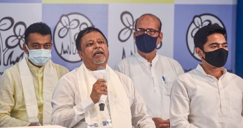 BJP leader Mukul Roy with TMC National General Secretary Abhisekh Banerjee during his re-joining of TMC party, at TMC Bhavan in Kolkata on June 11, 2021. (PTI Photo)